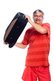 Senior man holding luggage Stock Photos