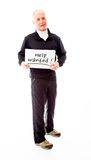 Senior man holding a message board with the text words Help wan Royalty Free Stock Photography
