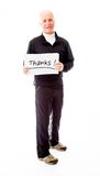 Senior man holding a message board with the text words Thanks Royalty Free Stock Photo