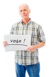 Senior man holding a message board with the text words Vote Royalty Free Stock Image
