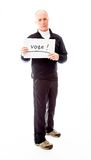 Senior man holding a message board with the text words Vote Royalty Free Stock Photos