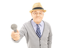 Senior man holding a microphone Stock Images