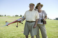 Senior Man Holding Model Plane By Woman On Field Stock Photos