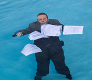 Senior man holding mortgage loan document in water Royalty Free Stock Image