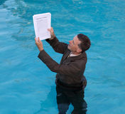 Senior man holding mortgage loan document in water Stock Photos