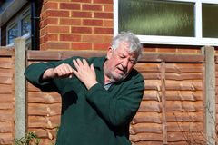 Senior man holding  painful shoulder. Stock Images