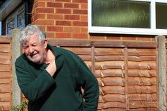 Senior man holding  painful shoulder. Stock Photo