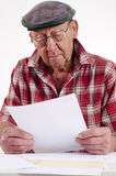 Senior man holding paper Stock Photo