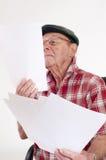 Senior man holding paper Stock Image