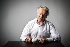 Old man holding piggy bank. Senior man holding piggy bank. Financial security planning concept Royalty Free Stock Photos