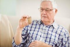 Senior man holding a pill bottle Stock Photos