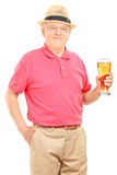 Senior man holding a pint of beer. Isolated on white background royalty free stock photos