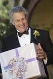 Senior Man Holding Present stock images