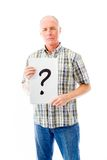 Senior man holding question mark sign Royalty Free Stock Image