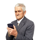 Senior man holding a smartphone Stock Image