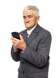 Senior man holding a smartphone Stock Images