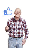 Senior man holding a social media sign smiling Royalty Free Stock Images