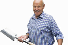 senior man holding spade, cut out Stock Image