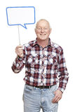 Senior man holding a speech bubble sign smiling Royalty Free Stock Image