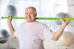 Senior man holding sport stick Royalty Free Stock Photo