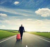 Senior man holding suitcase and walking Stock Image