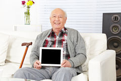 Senior man holding tablet computer Royalty Free Stock Photography