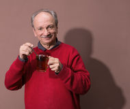 Senior man holding tea cup Royalty Free Stock Photography