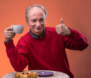 Senior man holding tea cup Royalty Free Stock Photo