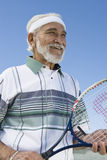 Senior Man Holding Tennis Racket Royalty Free Stock Photo