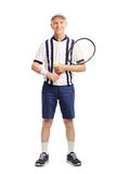 Senior man holding a tennis racket and a ball Stock Photography