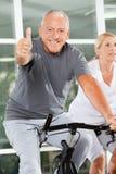 Senior man holding thumbs up on Stock Image