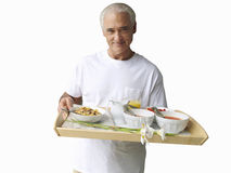 Senior man holding tray of food, cut out royalty free stock images