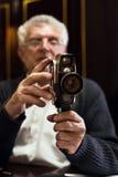 Senior man holding video Camera Stock Photography