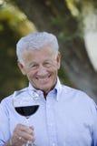 Senior Man Holding Wine Glass Royalty Free Stock Images