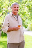 Senior man holding wine glass Stock Image