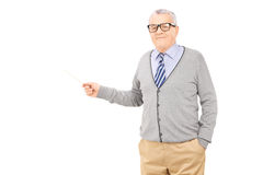 Senior man holding a wooden stick Royalty Free Stock Photo