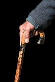 Senior man holding a wooden walking stick Stock Photography