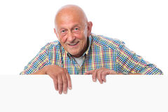 Senior man holds a blank board Royalty Free Stock Photography