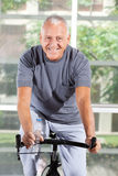 Senior man on home trainer in gym Royalty Free Stock Images