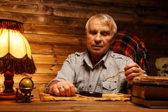 Senior man  in homely interior Stock Photo