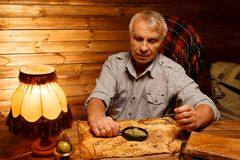 Senior man in homely interior Stock Images