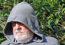 A  Senior man in hood hiding . Close up Stock Image