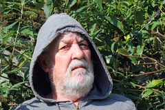 Senior man in hood looking serious. Close up Royalty Free Stock Photo