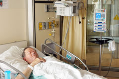 Senior man in hospital bed Royalty Free Stock Photo