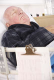 Senior man in hospital bed Royalty Free Stock Image