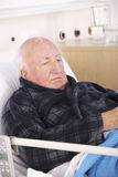 Senior man in hospital bed Royalty Free Stock Photography