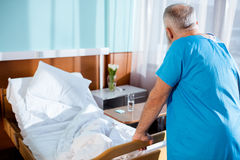 Senior man in hospital Stock Images