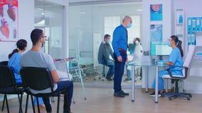 Senior man at hospital reception during COVID-19