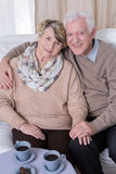 Senior man hugging wife Stock Images