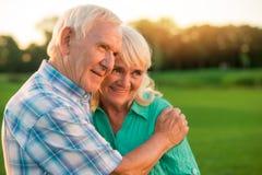 Senior man hugging woman. Stock Photos